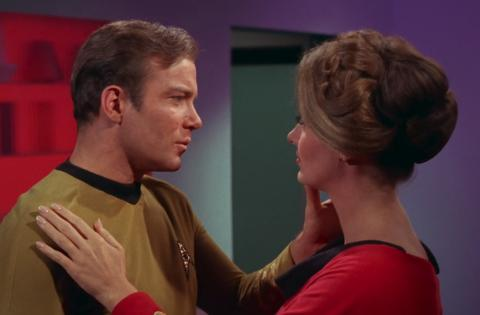 Kirk and Mulhall are about to kiss.